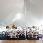 tent with high floral centerpieces