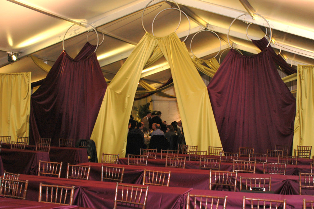 tented event space with tables and chairs