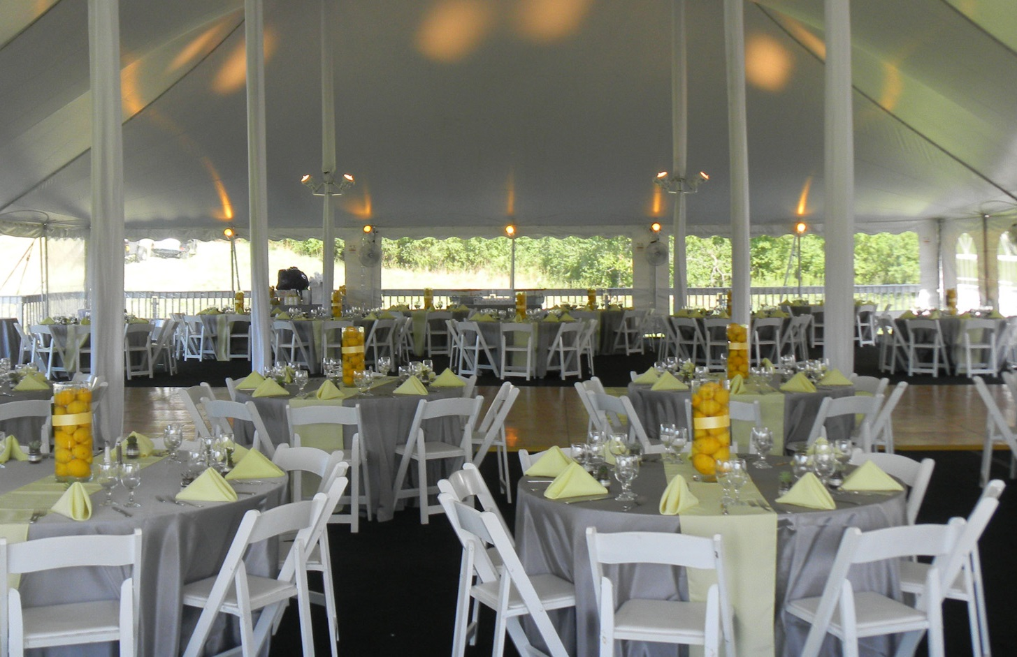 wedding tent with lemon centerpieces